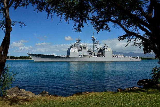The Ticonderoga-class guided-missile cruiser USS Port Royal (CG 73) passes by the Waianae Mountains as the ship departs Joint Base Pearl Harbor-Hickam, June 2011. (U.S. Navy photo by Mass Communication Specialist 2nd Class Daniel Barker/Released)