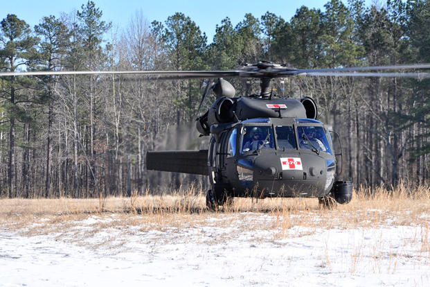 Soldiers from the Sandston-based Detachment 2, Company G, 2nd Battalion, 135th Aviation Regiment conduct hoist familiarization training Jan. 24, 2014, at Fort A.P. Hill. (Photo by Staff Sgt. Terra C. Gatti, Virginia Guard Public Affairs)