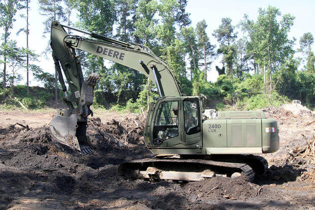A U.S. Soldier in the 1782nd Engineer Company, South Carolina Army National Guard, operates an excavator while conducting annual training at the Savannah River Site in Aiken, South Carolina, June 13, 2016. (U.S. Army/Sgt. Brad Mincey)