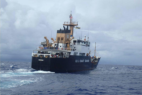 A USCGC Kukui (WLB 203) boarding team, with a shiprider from the Republic of the Marshall Islands, returns to the ship following a successful boarding with the fishing vessel Lomato in the Pacific Ocean Aug. 29, 2015. (U.S. Coast Guard photo)