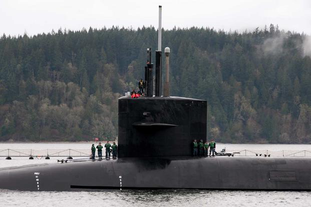 he Gold crew of the Ohio-class ballistic-missile submarine USS Louisiana (SSBN 743) arrives home to Naval Base Kitsap-Bangor following a routine strategic deterrence mission. (U.S. Navy photo by Lt. Cmdr. Michael Smith/Released)