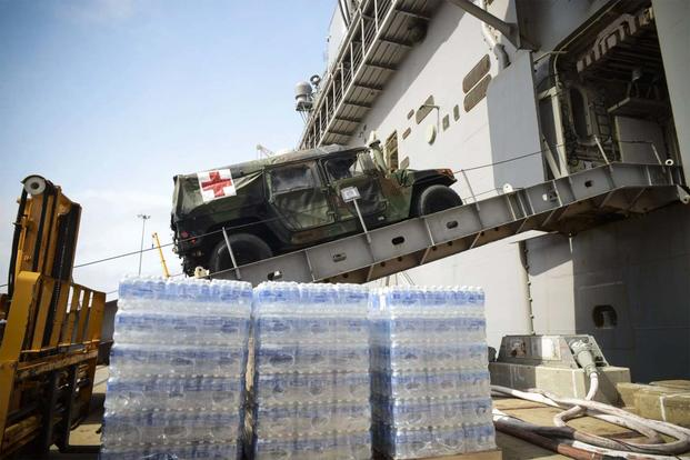 FILE - A medical vehicle attached to the 24th MEU drives aboard the amphibious assault ship USS Iwo Jima (LHD 7). (U.S. Navy photo: Petty Officer 3rd Class Jess E. Toner)
