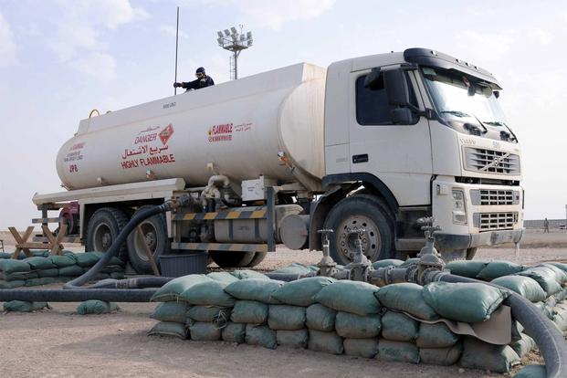 A fuel truck downloads fuel at the bulk fuel farm on Contingency Operating Base Adder, Iraq, Nov. 5, 2011. (Photo Credit: Spc. Anthony Zane, 362nd Mobile Public Affairs Detachment)