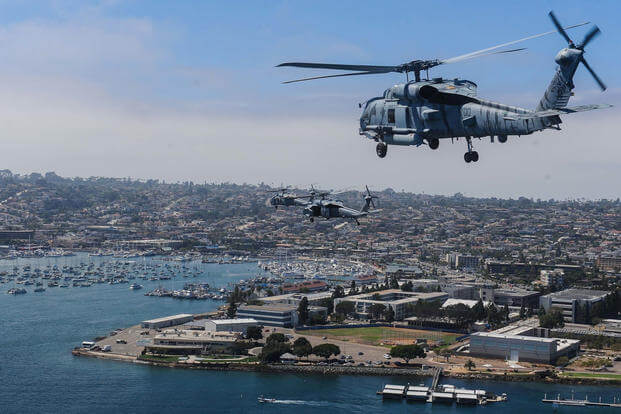 A group of MH-60 Seahawks fly over San Diego Bay during San Diego Fleet Week Sea and Air Parade, Sept. 10, 2016. (U.S. Navy/Mass Communication Specialist 3rd Class Paul L. Archer)