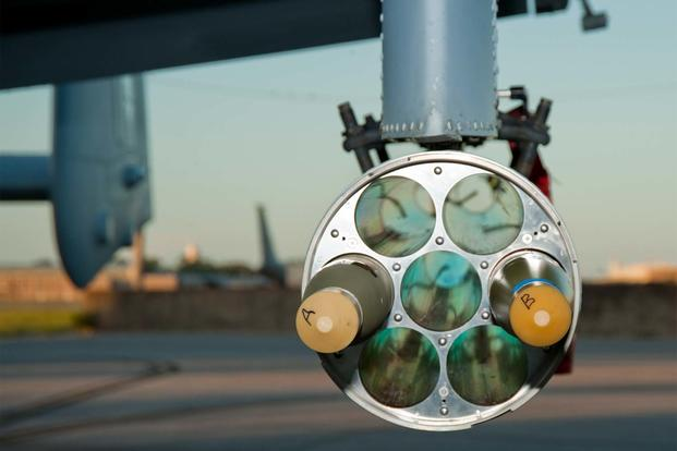 M151 warhead rounds integrated with the Advanced Precision Kill Weapon System II are loaded on an A-10 ahead of a test mission on Eglin Air Force Base, Fla. (Air Force Photo)