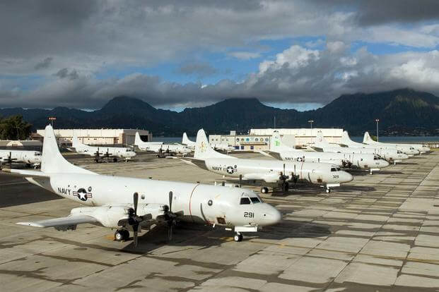 FILE PHOTO -- P-3C Orion aircraft line the Rainbow Fleet tarmac of Marine Corps Air Station Kaneohe Bay during the Rim of the Pacific (RIMPAC) 2010 exercise. (U.S. Navy/Mass Communication Specialist 2nd Class Meagan E. Klein)