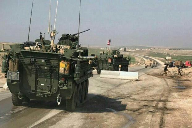 Photos of Strykers and up-armored Humvees flying U.S. flags were posted on social media over the weekend after the U.S. regional command confirmed that Special Forces troops in Syria had moved toward Manbij. (Qalaat Al Mudiq/Twitter)
