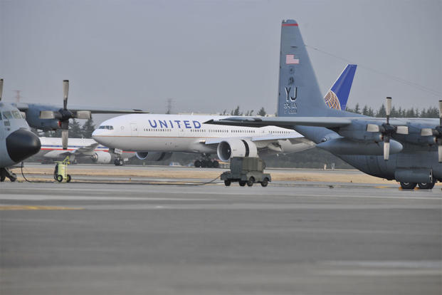 A United Airlines flight lands here March 11, 2011 after diverting from Narita International Airport, Tokyo, Japan. (U.S. Air Force photo/Master Sgt. Kimberly Spinner)