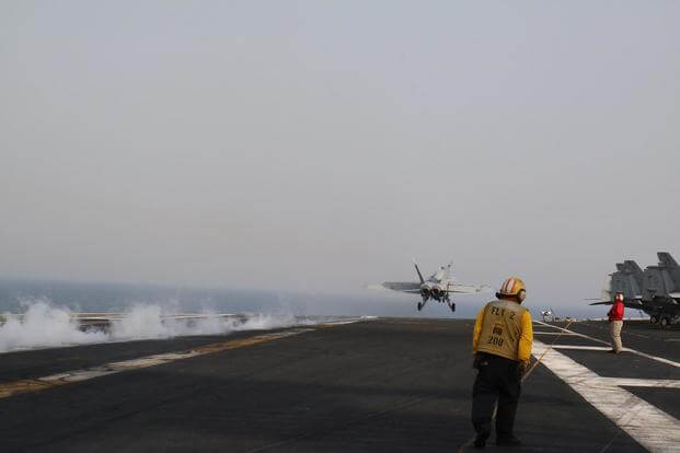 An F/A-18 Hornet completes a catapult launch from the deck of the carrier George H.W. Bush in the Middle East. Twice since the carrier deployed in January, pilots have experienced hypoxia-like episodes in the cockpit. Hope Hodge Seck/Military.com