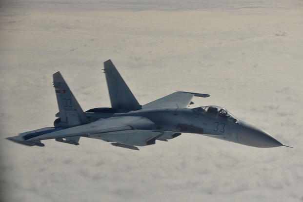 A Russian Federation Air Force Su-27 Sukhoi intercepts a simulated hijacked aircraft entering Russian airspace, Aug. 27, 2013 at Exercise Vigilant Eagle (VE) 13.(U.S. Air Force photo/Tech. Sgt. Jason Robertson)