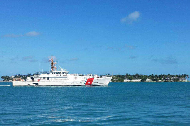 The crew of the Coast Guard Cutter Oliver Berry (WPC 1124) cruises out of Key West, Fla., following the cutter's delivery to the Coast Guard, June 27, 2017. (U.S. Coast Guard photo/Lt. j.g. Peter Driscoll)