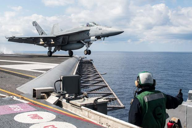 FILE -- An F/A-18E Super Hornet launches from the carrier USS George H.W. Bush (CVN 77) to perform strike operations in support of Operation Inherent Resolve. (U.S. Navy/Mass Communication Specialist 3rd Class Christopher Gaines)
