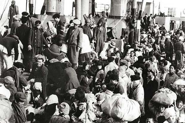 Korean refugees on the main deck of the SS Meredith Victory (Photo: US Navy)