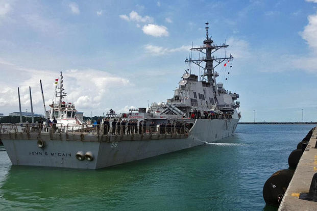 Guided-missile destroyer USS John S. McCain arrives pier side at Changi Naval Base, Republic of Singapore following a collision with a merchant vessel while underway east of the Straits of Malacca and Singapore on Aug. 21, 2017. (U.S. Navy/Joshua Fulton)