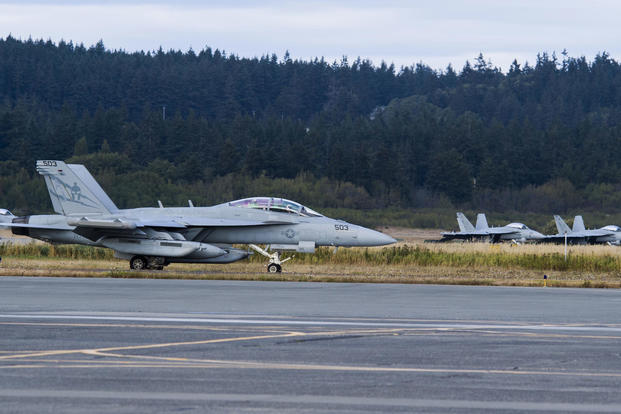 "An EA-18G Growler aircraft assigned to the ""Lancers"" of Electronic Attack Squadron (VAQ-131) taxis down the airstrip on Naval Air Station Whidbey Island during the squadron's welcome home ceremony, August 18, 2017. (U.S. Navy photo/Scott Wood)"