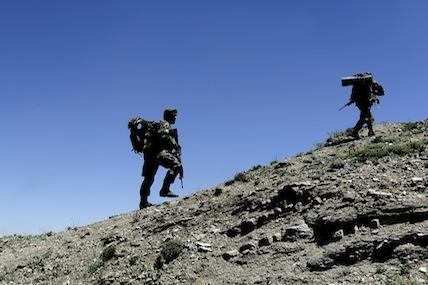 U.S. Air Force and Afghan air force security forces conduct a joint patrol