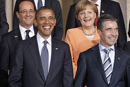 From left to right, French President Francois Hollande, President Barack Obama, German Chancellor Angela Merkel and Secretary General Anders Fogh Rasmussen, during the NATO family photo at Soldier Field at the NATO Summit in Chicago.