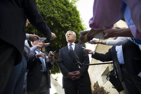 Defense Secretary Chuck Hagel speaks with reporters after leaving Egypt for Abu Dhabi. Hagel said on Thursday that U.S. intlligence now believes Syria has used the sarin gas in its fight against rebels.AP photo