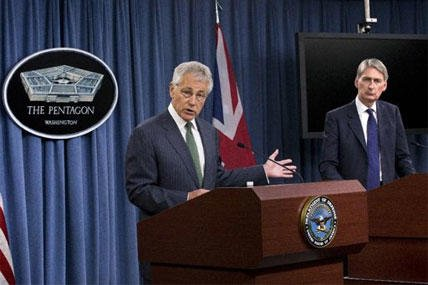 Defense Secretary Chuck Hagel, accompanied by British Defense Secretary Philip Hammond speaks during their joint news conference at the Pentagon, Thursday, May 2, 2013,. (AP Photo/J. Scott Applewhite)