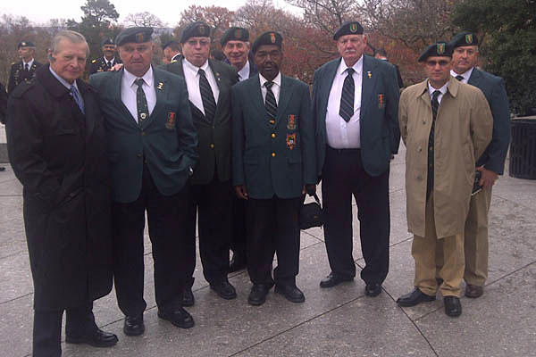 "Mohler poses with Special Forces Association members at Arlington National Cemetery in 2011. His SFA application claimed he served with Special Forces. The ""rescinded"" order for his Distinguished Service Cross stated he served with 75th Infantry (Ranger)."