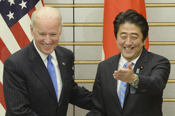 U.S. Vice President Joe Biden, left, is welcomed by Japanese Prime Minister Shinzo Abe prior to their talks at Abe's official residence in Tokyo Tuesday, Dec. 3, 2013.