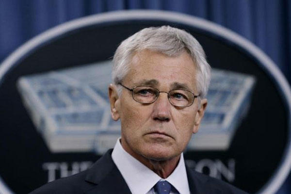 Defense Secretary Chuck Hagel listens during a news conference at the Pentagon, Monday, Feb. 24, 2014. (AP Photo/Carolyn Kaster)