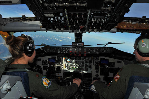 Maj. Gena Fedoruk and Maj. Stephanie Blech fly a KC-135 Stratotanker during a refueling mission March 13, 2014.