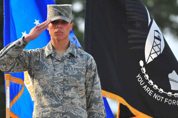 Senior Airman Amber Coley renders a salute as the U.S. military Code of Conduct is recited during the 4th Fighter Wing Prisoner of War/Missing in Action ceremony Sept. 20, 2013, at Seymour Johnson Air Force Base, N.C.