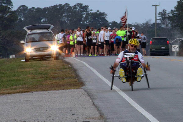 Paul Kelly, avid hand-cyclist, takes off from the starting line of the15th Annual Marine Corps Air Station Cherry Point Half Marathon March 22, 2014.
