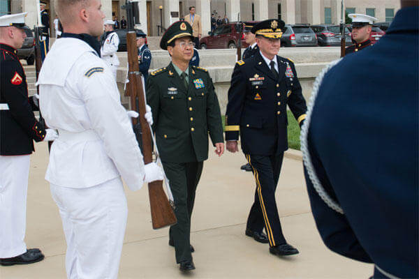 U.S. Army Gen. Martin E. Dempsey, right, chairman of the Joint Chiefs of Staff, and Chinese Army Gen. Fang Fenghui, chief of the general staff, walk together during a full-honor arrival ceremony at the Pentagon, May 15, 2014DOD photo by D. Myles Cullen