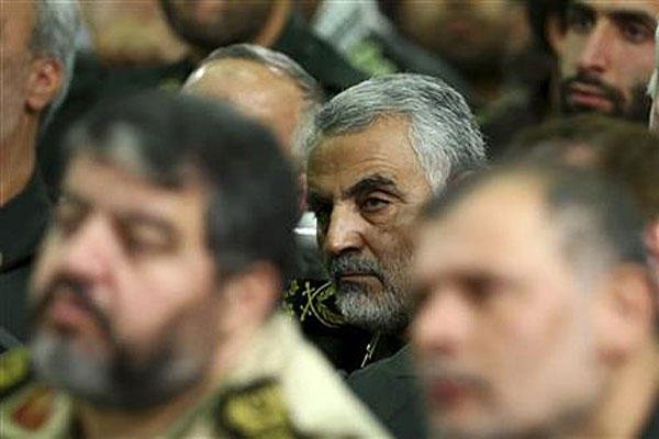 In this 2013 photo released by an official website of the office of the Iranian supreme leader, then chief of the Quds Force of Iran's Revolutionary Guard, Ghasem Soleimani, attends a meeting of the commanders of the Revolutionary Guard.