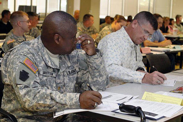 Warrior Transition Unit Soldier Maj. Lonnie Britton, 479th Field Artillery Brigade, listens to instructions on how to fill out the Individual Transition Plan that is part of the new Transition Assistance Program, or TAP.