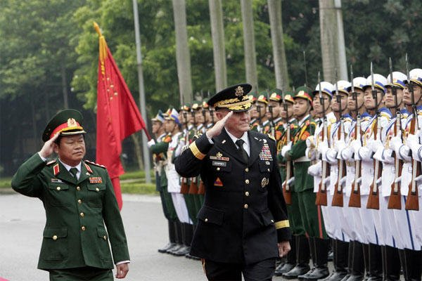 Chairman of the Joint Chiefs of Staff, Gen. Martin Dempsey and Vietnamese Chief of General Staff of the Army, Lt. Gen. Do Ba Ty review an honor guard before their talks in Hanoi, Vietnam on Thursday Aug. 14, 2014. (AP Photo/Tran Van Minh)