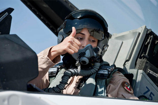 This June 13, 2013 photo provided by the Emirates News Agency, WAM, shows Mariam al-Mansouri, the first Emirati female fighter jet pilot gives the thumbs up as she sits in the cockpit of an aircraft, in United Arab Emirates .(AP Photo/Emirates News Agency