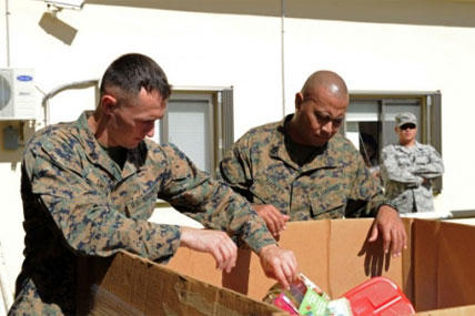 Sgt. Robert Smith (left) and Gunnery Sgt. Omar Hadley (right) assigned to Marine Corps Activity Guam (MCAG) deliver toys to the Salvation Army to support the Toys for Tots foundation. (Photo by Mass Communication Specialist 2nd Class Chelsy Alamina)