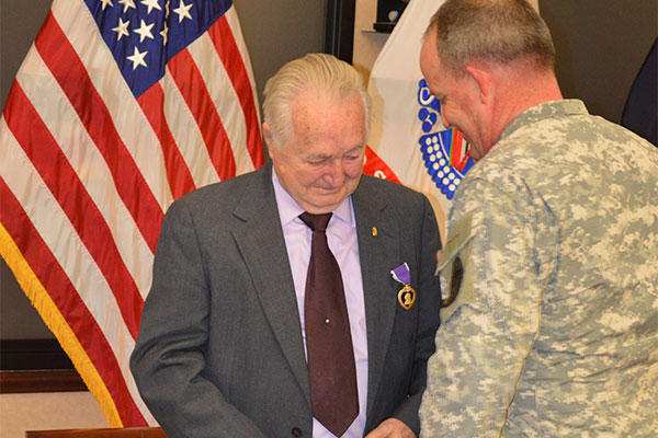 Clifford L. Land received the Purple Heart for wounds he received during hostile enemy fire while stationed in Korea from April 3, 1952 to April 15, 1954 from Lt. Col. Craig S. Besaw. (Jason B. Cutshaw/U.S. Army)