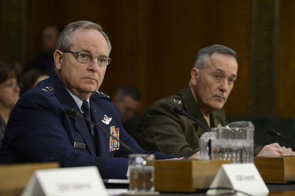 Air Force Chief of Staff Gen. Mark A. Welsh III testifies before the Senate Armed Services Committee Jan. 28, 2015, in Washington, D.C., as Commandant of the Marine Corps Gen. Joesph F. Dunford Jr., looks on. (U.S. Air Force photo/Scott M. Ash)