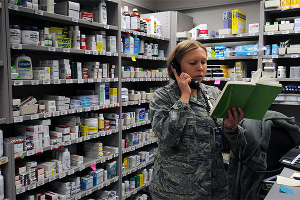 Capt. Christine Cox, 21st Medical Squadron pharmacist and support flight commander, reviews her notes at Schriever Air Force Base, Colorado (U.S. Air Force photo/Staff Sgt. Julius Delos Reyes)