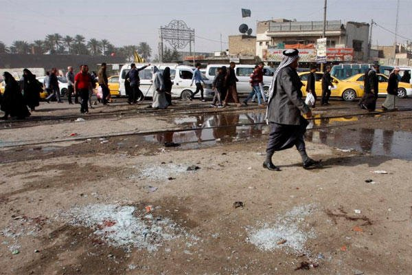 Broken glass remains at the scene of a suicide bomb attack at Adan Square, located in a predominantly Shiite part of the capital, Baghdad, Iraq, Monday, Feb. 9, 2015. (AP Photo)