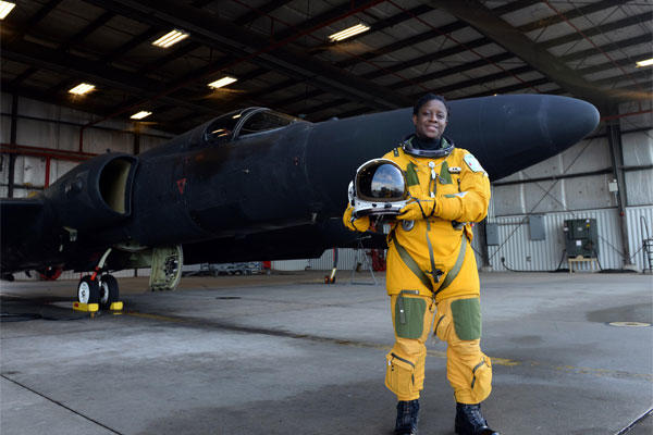 Lt. Col. Merryl Tengesdal stands in front of a U-2 Feb. 9, 2015, at Beale Air Force Base, Calif. Tengesdal is the only black female U-2 pilot in history.. (U.S. Air Force photo/Senior Airman Bobby Cummings)