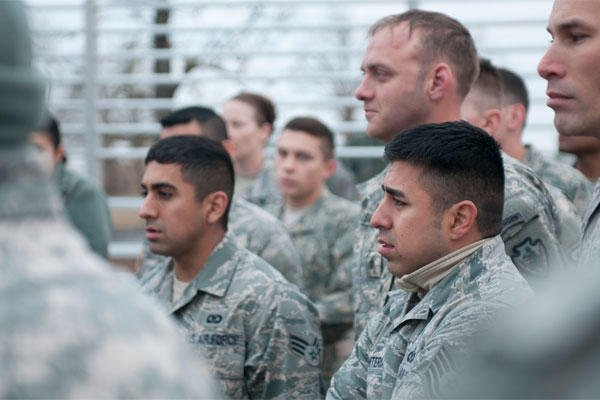 Fraternal twins Air Force Tech. Sgt. Matthew Renteria and Air Force Senior Airman Michael Pineda listen to a briefing at the Texas Military Forces Best Warrior Competition, Feb. 5, 2015. U.S. Army photo by Spc. Michael Giles