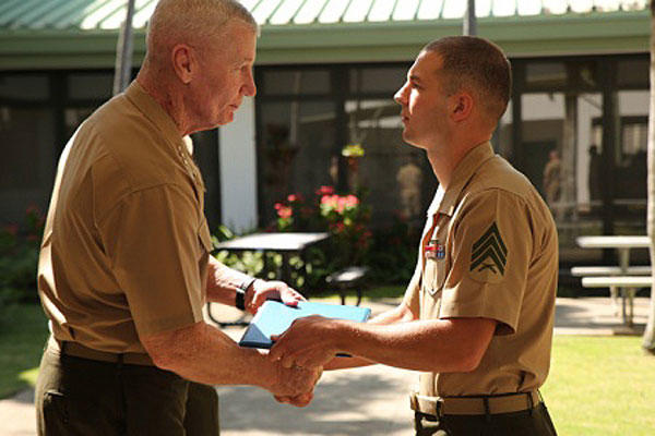 Marine Corps Sgt. Michael Joseph receives the Emergency Cardiovascular Care Heart Saver Hero Award from U.S. Marine Corps Forces Pacific Commander Lt. Gen. John A. Toolan, March 13, 2015. U.S. Marine Corps photo: Sgt. Sarah Dietz