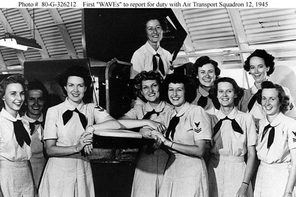 A file photograph dated July 24, 1945 shows the first group of WAVES to report for duty with VR-12 at Naval Air Station, Quonset Point, R.I. (U.S. Navy photo/Released)