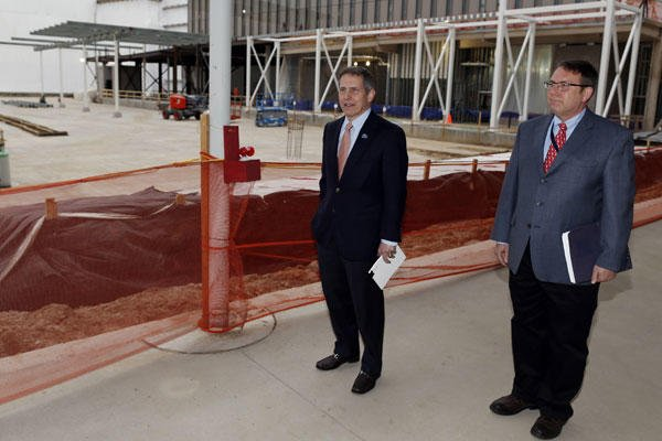VA Deputy Secretary Sloan Gibson, left, and Kevin Lindsey, with the VA's office of construction and facilities, look over work at the construction site of the Veterans Affairs hospital in Aurora, Colo., on April 2. David Zalubowski/AP