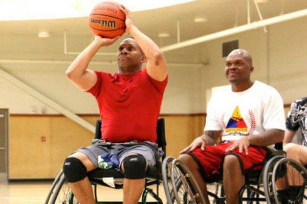 "Sgt. 1st Class Kevin ""Smiley"" Hawkins focuses on making his shot during the 2015 Army Trials wheelchair basketball practice on Fort Bliss, Texas. (U.S. Army Medical Activity, Fort Drum, N.Y.)"