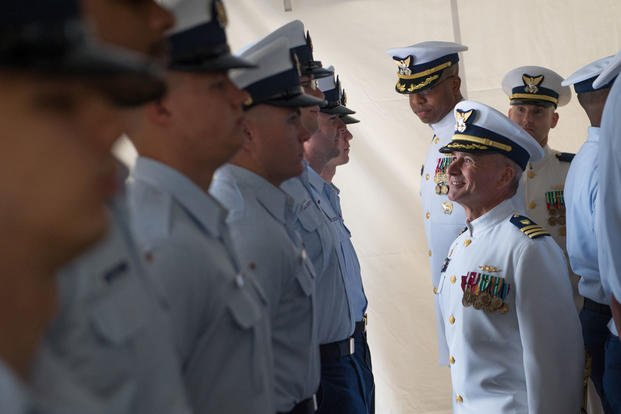 Cmdr. Arthur Ray relieved Cmdr. Terry Johns as commanding officer of the Coast Guard Cutter Vigorous during a change of command ceremony at Joint Expeditionary Base Little Creek-Fort Story. (U.S. Coast Guard photo by Petty Officer 2nd Class Walter Shinn)