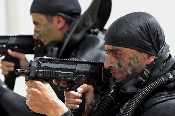 Jordanian forces practice a drill to free a ship May 18, 2015 during 18-nation military exercises in Jordan. (Raad Adayleh/AP)