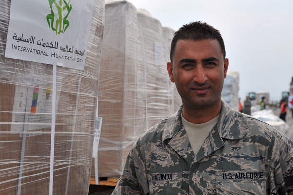 Senior Airman Manoj Khatiwada stands in front of a pallet of humanitarian assistance and disaster relief supplies at Tribhuvan International Airport in Kathmandu, Nepal, May 8, 2015. (U.S. Air Force photo/Staff Sgt. Melissa White)