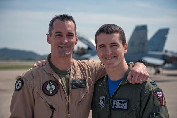 Marine Corps Capt. Jarrod Allen, an F/A-18 Hornet pilot with Marine Fighter Attack Squadron 225, and Air Force Capt. Jacob Allen, an F-16 Fighting Falcon pilot with the 35th Fighter Squadron, April 17, 2015. U.S. Air Force photo/Senior Airman Taylor Curry