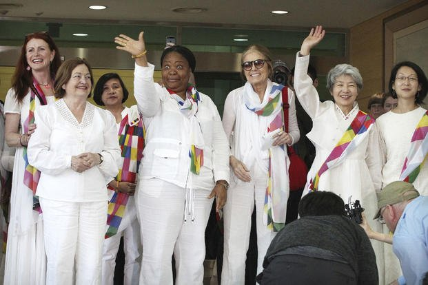 From second left, Nobel Peace Prize laureates Mairead Maguire and Leymah Gbowee, Gloria Steinem and other activists smile on their arrival from North Korea in Paju, South Korea, near the border village of Panmunjom, on May 24. Ahn Young-joon/AP